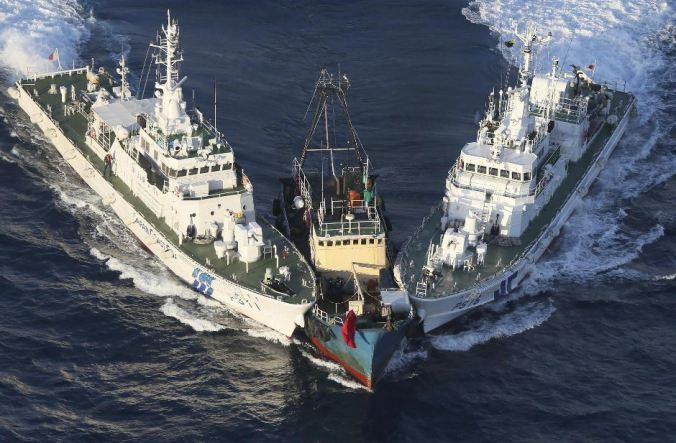Japan's Coast Guard intercepts an activist Chinese boat on Aug. 15, 2012 near the Senkaku/Diaoyu islands. (AP Photo/Yomiuri Shimbun, Masataka Morita)